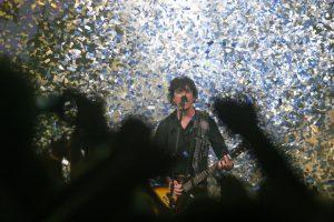Billie Joe Armstrong of Green Day performs in a shower of graffiti last summer at KeyArena (photo: www.stevenfriederich.com)