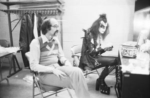 Larry Harris with Gene Simmons (photo: Fin Costello/Redferns)