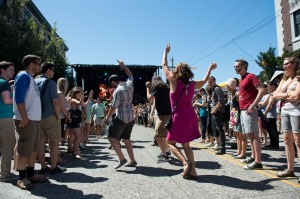 Festivalgoers dance in the street on Saturday (photo: Jim Bennett)