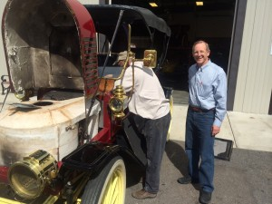 Museum owner Tim Cerny (right) and museum manager Willy Vinton prepare a 1910 Stanley Steamer for display (photo: Gene Stout)