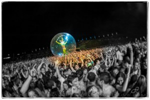 Dancer surfing the crowd inside a ball (photo: Mike Savoia)