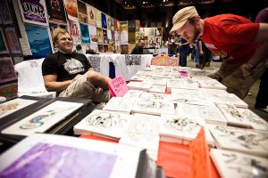 Vendor at Flatstock poster show (photo: Christopher Nelson)